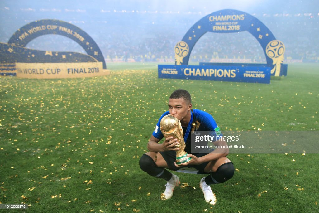 Kylian Mbappe of France kisses the trophy after the 2018 FIFA World Cup Russia Final between France and Croatia at the Luzhniki Stadium on July 15, 2018 in Moscow, Russia.