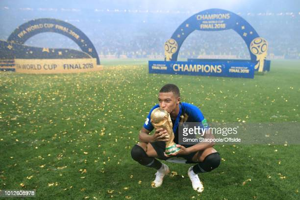 Kylian Mbappe of France kisses the trophy after the 2018 FIFA World Cup Russia Final between France and Croatia at the Luzhniki Stadium on July 15...