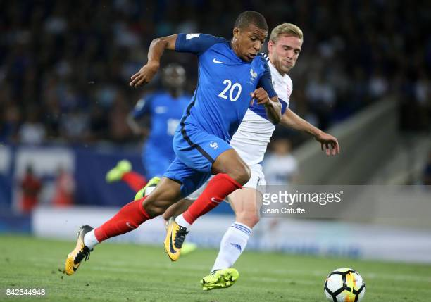 Kylian Mbappe of France Laurent Jans of Luxembourg during the FIFA 2018 World Cup Qualifier between France and Luxembourg at the Stadium on September...