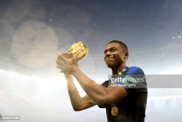 Kylian Mbappe of France lifts the World Cup trophy following the 2018 FIFA World Cup Final between France and Croatia at Luzhniki Stadium on July 15...