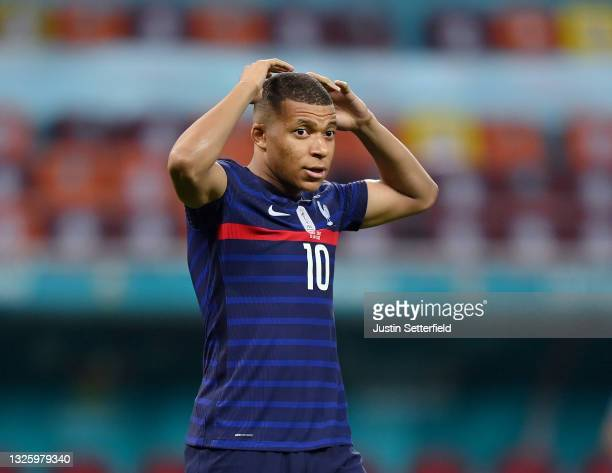 Kylian Mbappe of France looks dejected after having their side's decisive penalty saved by Yann Sommer of Switzerland in the penalty shoot out after...