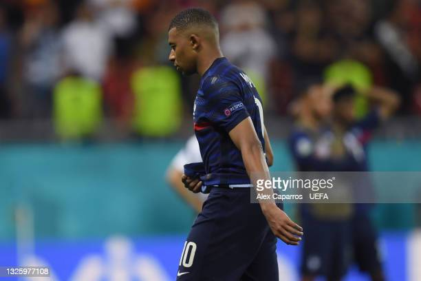 Kylian Mbappe of France looks dejected after missing their side's decisive penalty in the penalty shoot out after the UEFA Euro 2020 Championship...