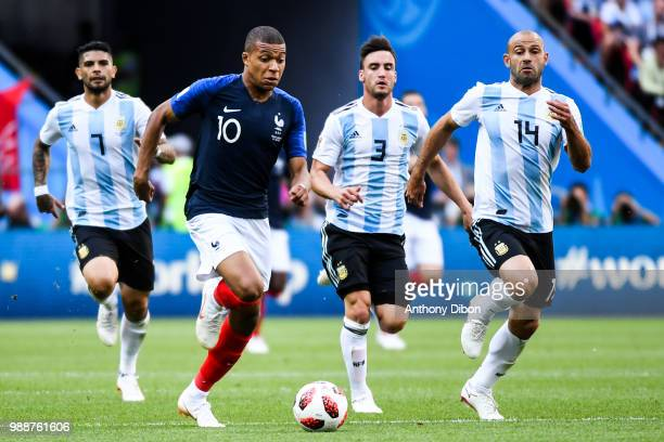 Kylian Mbappe of France Nicolas Tagliafico and Javier Mascherano of Argentina during the FIFA World Cup Round of 16 match between France and...