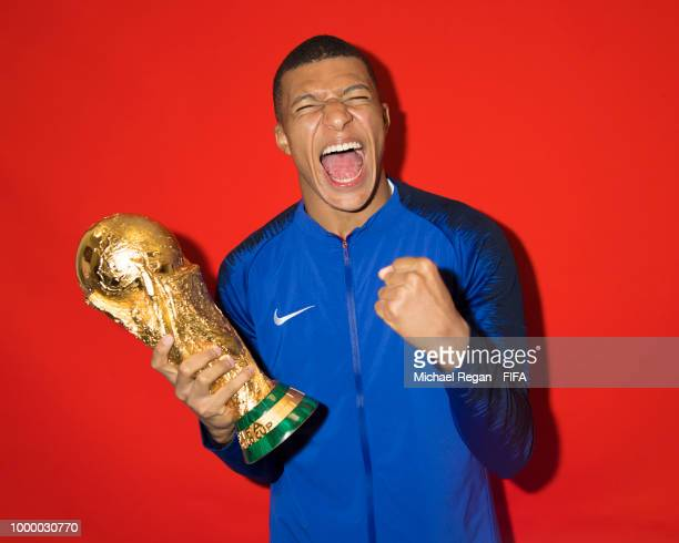 Kylian Mbappe of France poses with the Champions World Cup trophy after the 2018 FIFA World Cup Russia Final between France and Croatia at Luzhniki...