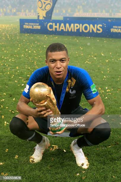 Kylian Mbappe of France poses with the trophy after the 2018 FIFA World Cup Russia Final between France and Croatia at the Luzhniki Stadium on July...