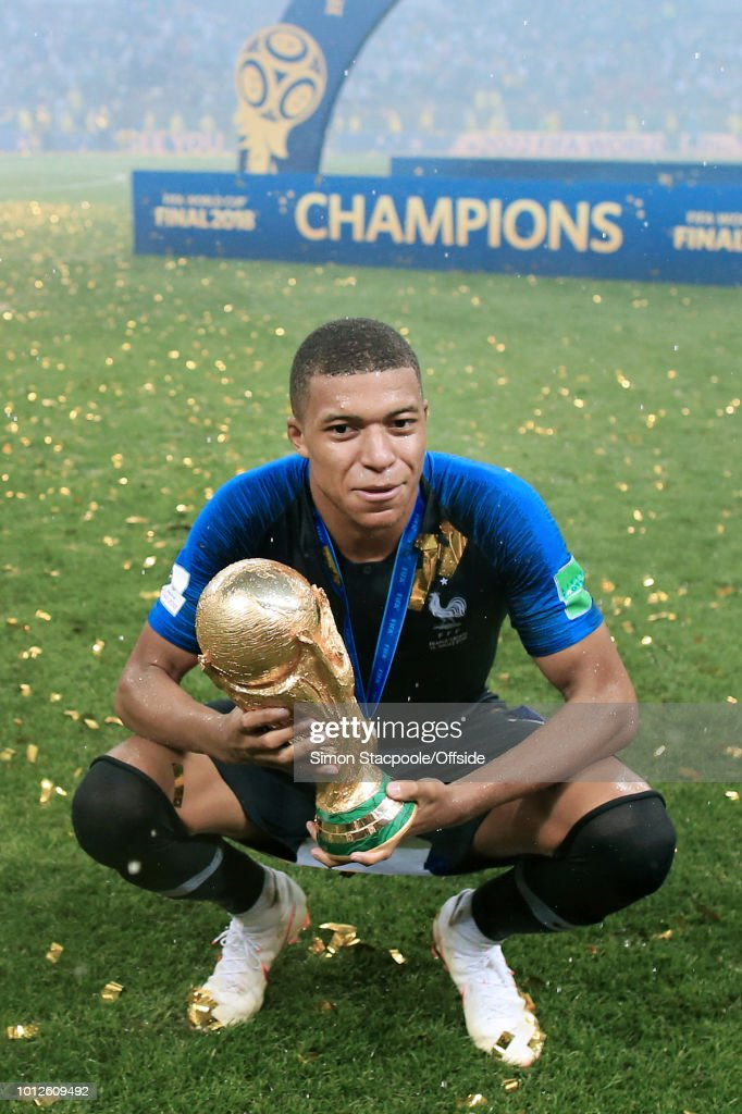 Kylian Mbappe of France poses with the trophy after the 2018 FIFA World Cup Russia Final between France and Croatia at the Luzhniki Stadium on July 15, 2018 in Moscow, Russia.