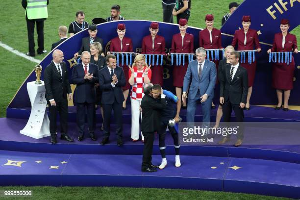 Kylian Mbappe of France receives his Best Young Player Award following the 2018 FIFA World Cup Final between France and Croatia at Luzhniki Stadium...