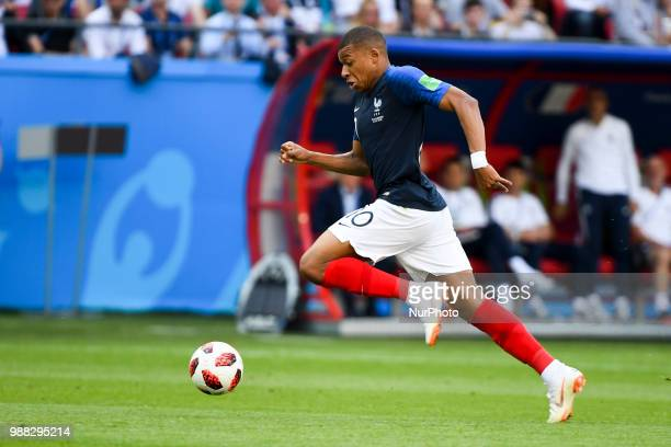 Kylian Mbappe of France runs with the ball during the 2018 FIFA World Cup Round of 16 match between France and Argentina at Kazan Arena in Kazan...