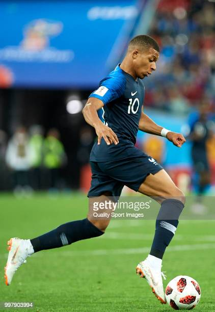 Kylian Mbappe of France runs with the ball during the 2018 FIFA World Cup Russia Semi Final match between Belgium and France at Saint Petersburg...
