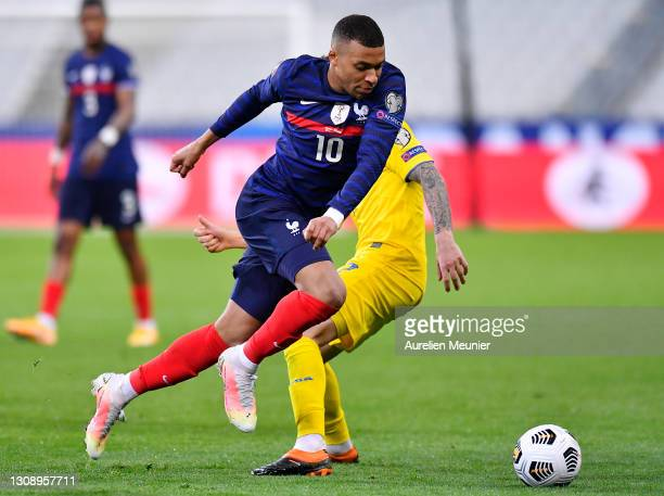 Kylian Mbappe of France runs with the ball during the FIFA World Cup 2022 Qatar qualifying match between France and Ukraine on March 24, 2021 in...