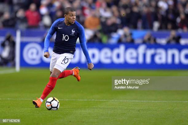 Kylian Mbappe of France runs with the ball during the international friendly match between France and Colombia at Stade de France on March 23 2018 in...