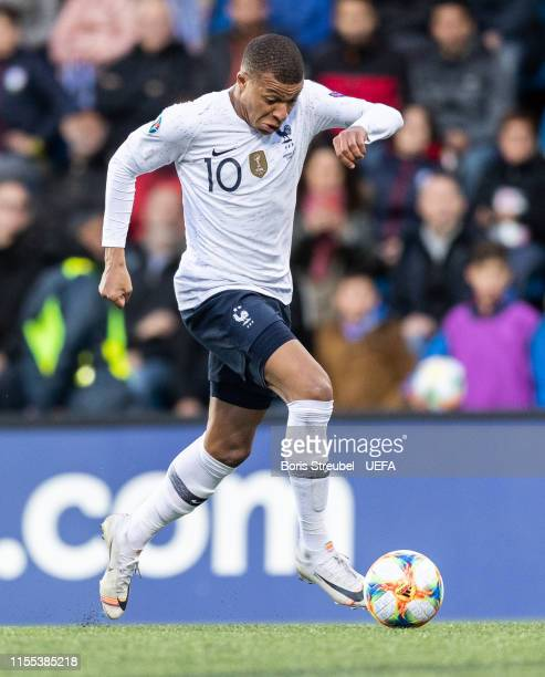 Kylian Mbappe of France runs with the ball during the UEFA Euro 2020 Qualifier Group H match between Andorra and France at Estadi Nacional on June 11...