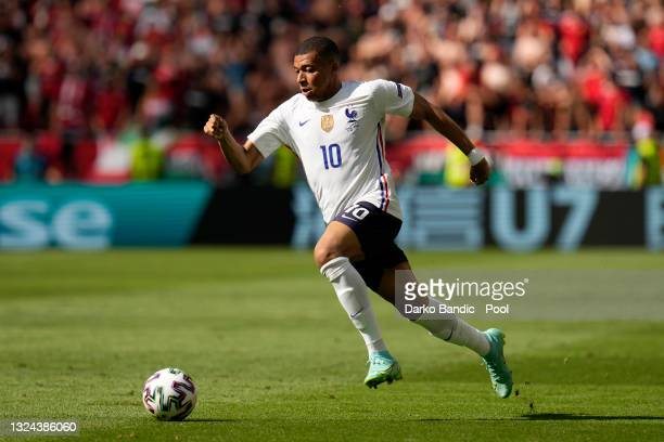Kylian Mbappe of France runs with the ball during the UEFA Euro 2020 Championship Group F match between Hungary and France at Puskas Arena on June...