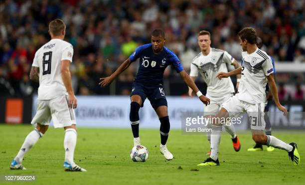 Kylian Mbappe of France runs with the ball during the UEFA Nations League group A match between Germany and France at Allianz Arena on September 6...