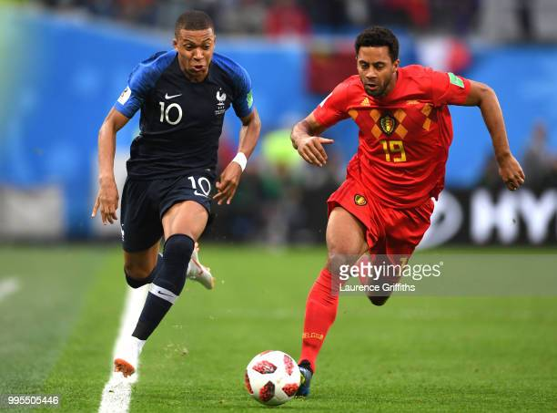 Kylian Mbappe of France runs with the ball under pressure from Moussa Dembele of Belgium during the 2018 FIFA World Cup Russia Semi Final match...