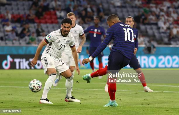 Kylian Mbappe of France scores a goal that is disallowed for offside whilst under pressure from Ilkay Guendogan of Germany during the UEFA Euro 2020...