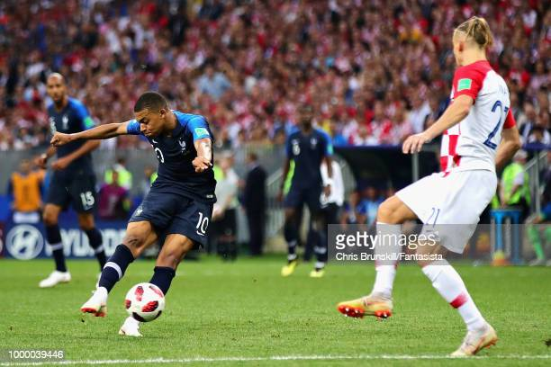 Kylian Mbappe of France scores his sides fourth goal during the 2018 FIFA World Cup Russia Final between France and Croatia at Luzhniki Stadium on...