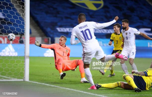 Kylian Mbappe of France scores his team's first goal during the UEFA Nations League group stage match between Sweden and France at Friends Arena on...