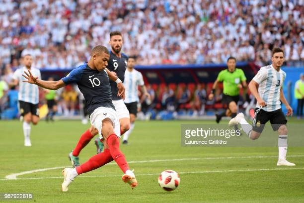 Kylian Mbappe of France scores his team's fourth goal during the 2018 FIFA World Cup Russia Round of 16 match between France and Argentina at Kazan...