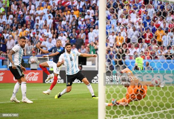 Kylian Mbappe of France scores his team's third goal past Franco Armani of Argentina during during the 2018 FIFA World Cup Russia Round of 16 match...