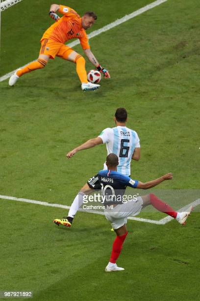 Kylian Mbappe of France scores past Franco Armani of Argentina his team's third goal during the 2018 FIFA World Cup Russia Round of 16 match between...