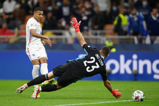 Kylian Mbappe of France scores their side's second goal past Unai Simon of Spain during the UEFA Nations League 2021 Final match between Spain and...