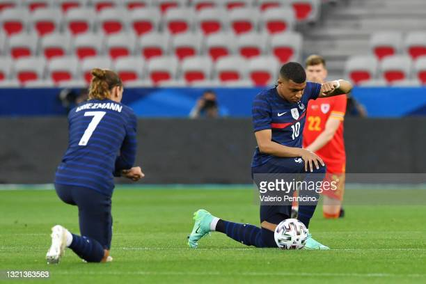 Kylian Mbappe of France takes the knee ahead of the international friendly match between France and Wales at Allianz Riviera on June 02, 2021 in...