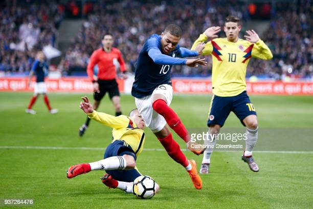 Kylian Mbappe of France tries to control the ball against Matheus Uribe of Colombia during the international friendly match between France and...