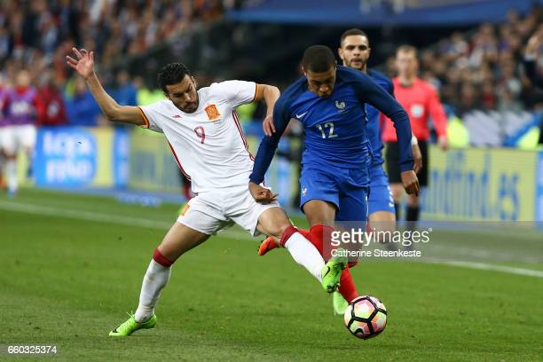 Kylian MBappe of France tries to controls the ball against Pedro Rodriguez of Spain during the International Friendly game between France and Spain...