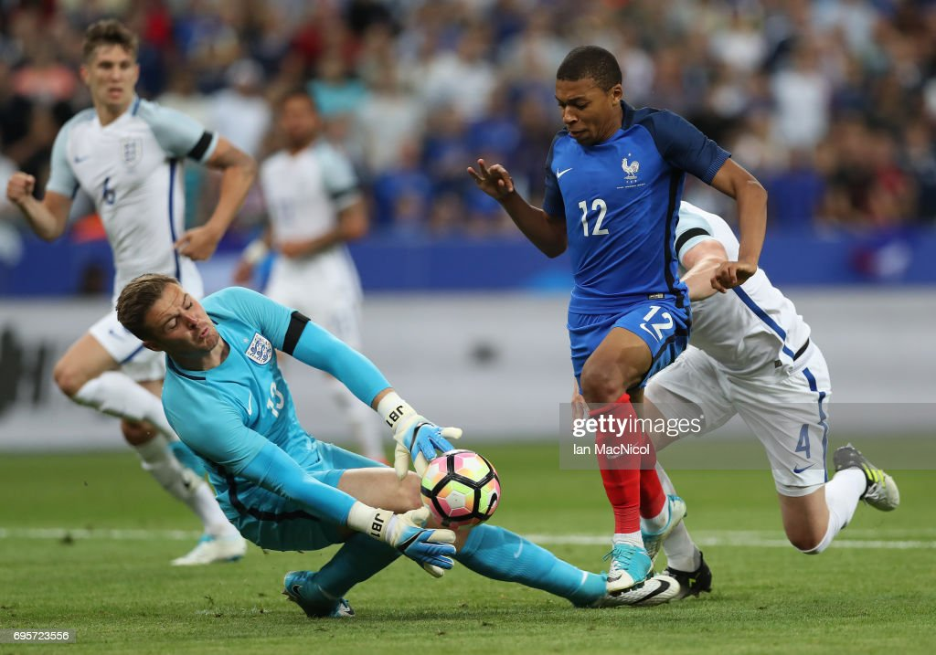 Kylian Mbappe of France vies with Tom Heaton of England during the international Friendly match between France and England at Stade de France, on June 13, 2017 in Paris, France.