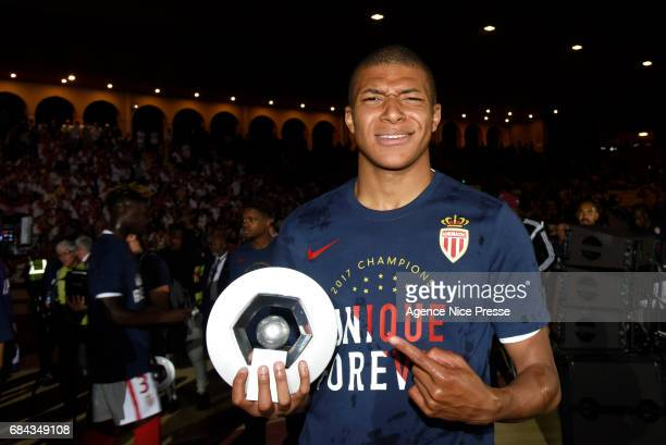 Kylian Mbappe of Monaco celebrates winning the Ligue 1 title during the Ligue 1 match between As Monaco and AS Saint Etienne at Stade Louis II on May...