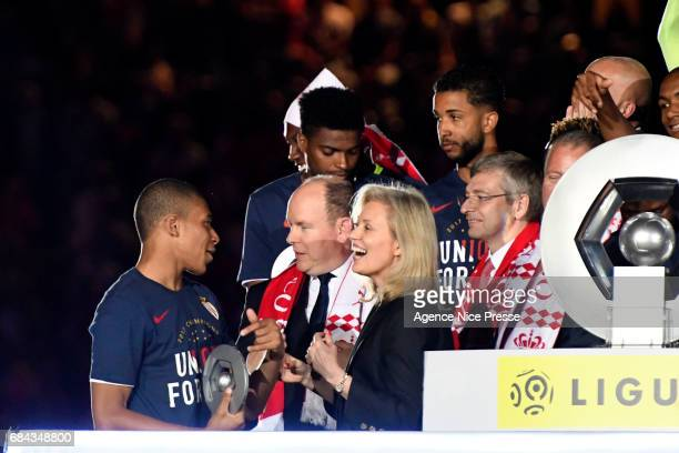 Kylian Mbappe of Monaco celebrates winning the Ligue 1 title with Prince Albert of Monaco and Nathalie Boy de la Tour president of LFP during the...
