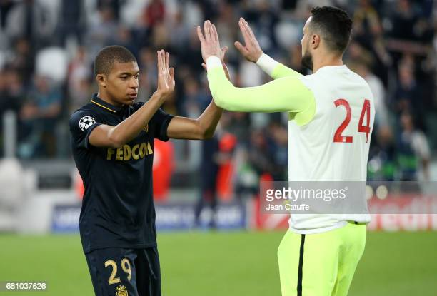 Kylian Mbappe of Monaco greets Andrea Raggi following the UEFA Champions League semi final second leg match between Juventus Turin and AS Monaco at...