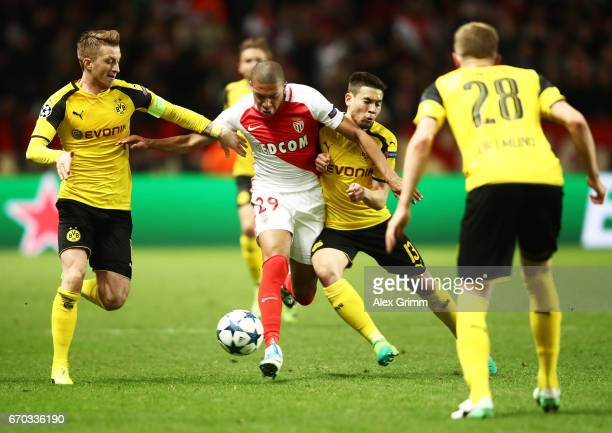 Kylian Mbappe of Monaco is challenged by Marco Reus and Raphael Guerreiro of Borussia Dortmund of Borussia Dortmund during the UEFA Champions League...