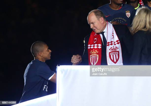 Kylian Mbappe of Monaco is greeted by Prince Albert II of Monaco during the French League 1 Championship title celebration following the French Ligue...