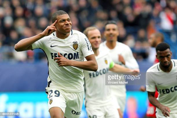 Kylian Mbappe of Monaco jubilates as he scores the first goal during the French Ligue 1 match between Caen and Monaco at Stade Michel D'Ornano on...