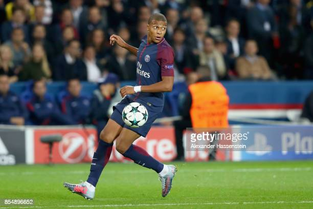 Kylian Mbappe of Paris runs with the ball during the UEFA Champions League group B match between Paris SaintGermain and Bayern Muenchen at Parc des...