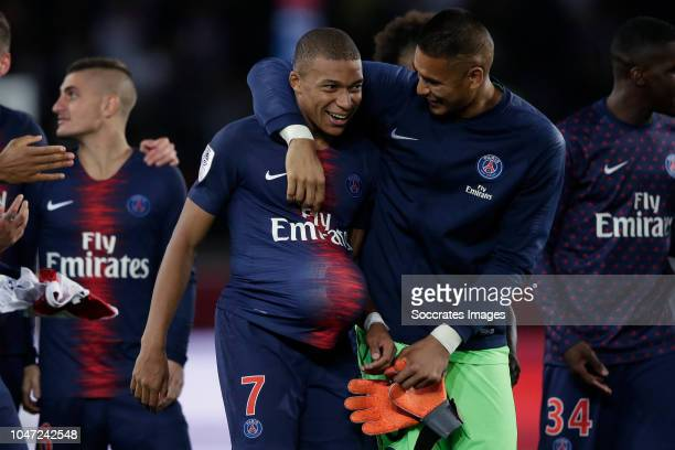 Kylian Mbappe of Paris Saint Germain Alphonse Areola of Paris Saint Germain celebrate the victory during the French League 1 match between Paris...