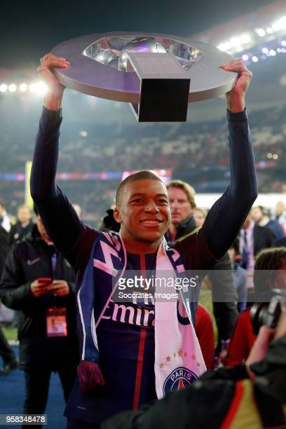 Kylian Mbappe of Paris Saint Germain celebrates the championship with the trophy during the French League 1 match between Paris Saint Germain v...