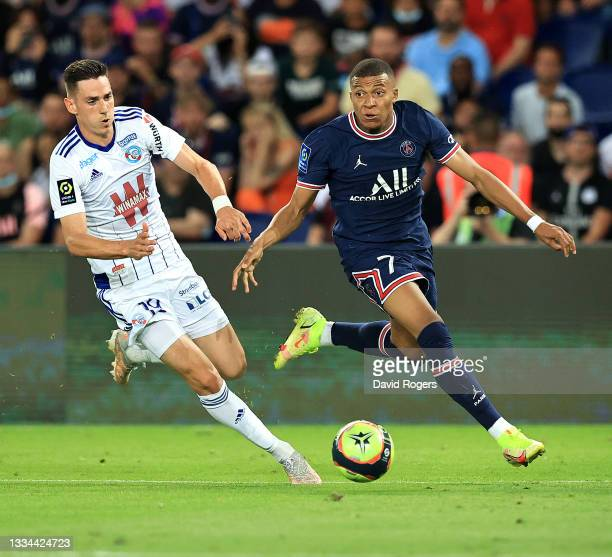 Kylian Mbappe of Paris Saint- Germain goes past Anthony Caci during the Ligue 1 Uber Eats match between Paris Saint Germain and Strasbourg at Parc...