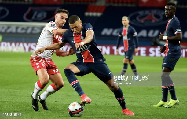 Kylian Mbappe of Paris Saint Germain in action with Ruben Aguilar of AS Monaco during the Ligue 1 soccer match between Paris Saint-Germain and AS...