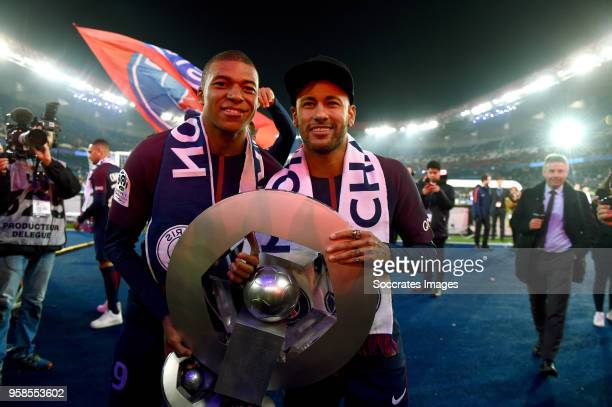 Kylian Mbappe of Paris Saint Germain Neymar Jr of Paris Saint Germain celebrates the championship with the trophy during the French League 1 match...