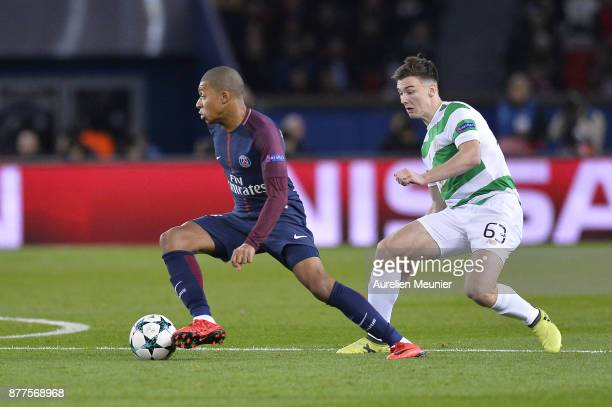 Kylian Mbappe of Paris SaintGermain and Kieran Tierney of Celtic Glasgow fight for the ball during the UEFA Champions League group B match between...