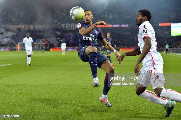 Kylian Mbappe of Paris SaintGermain and Marlon Santos of OGC Nice fight for the ball during the Ligue 1 match between Paris Saint Germain and OGC...