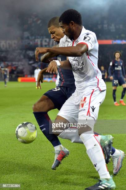 Kylian Mbappe of Paris SaintGermain and Marlon Santos of OGC Nice fight for the ball during the Ligue 1 match between Paris Saint Germain and OGC...