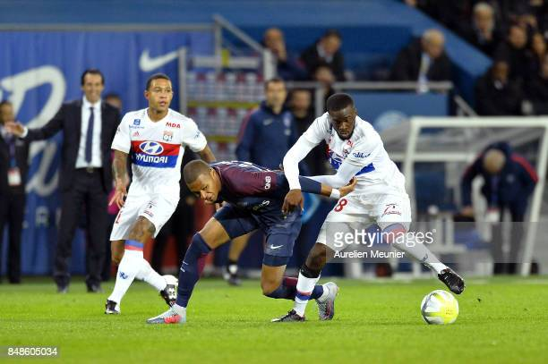 Kylian Mbappe of Paris SaintGermain and Tanguy Ndombele of Olympique Lyonnais fight for the ball during the Ligue 1 match between Paris Saint Germain...