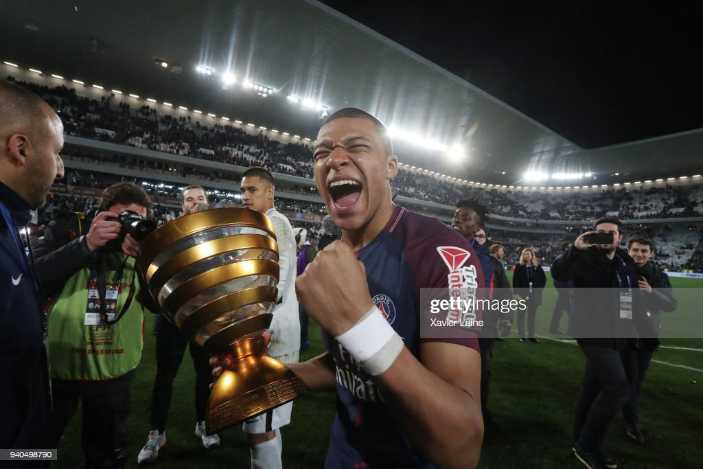 Kylian Mbappe of Paris Saint-Germain celebrate the cup during the League Cup Final match between Paris Saint-Germain (PSG) and AS Monaco at Matmut Arena on March 31, 2018 in Bordeaux France.