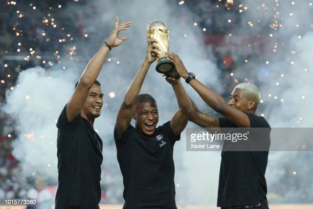 Kylian Mbappe of Paris SaintGermain celebrate the FIFA world cup with Alphonse Areola and Presnel Kimpembe before the Ligue 1 match between Paris...