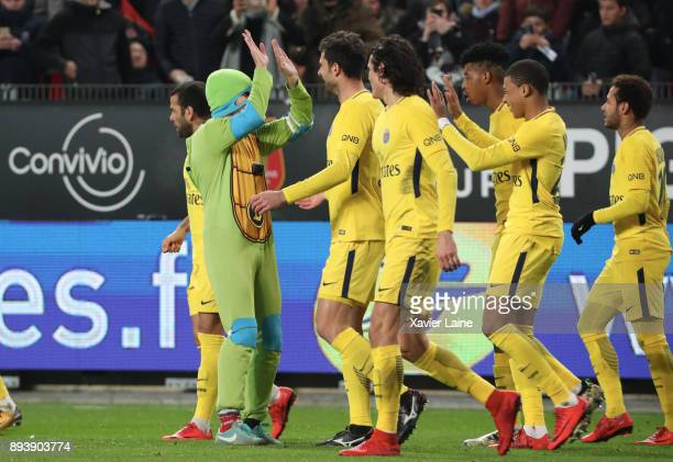 Kylian Mbappe of Paris SaintGermain celebrates a goal with a striker disguised as a turtle ninja during the Ligue 1 match between Stade Rennes and...