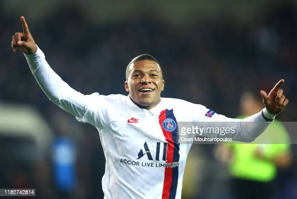 Kylian Mbappe of Paris SaintGermain celebrates after scoring his team's fifth goal during the UEFA Champions League group A match between Club Brugge...